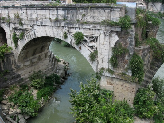 Ancient bridge section over Tiber River, Rome, Italy