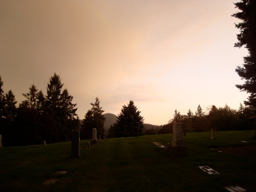 autumnal sunset over a cemetary